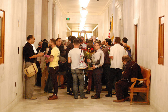 "The ""Airbnb Law"" was signed by Mayor Ed Lee in October 2014 at San Francisco City Hall, legalizing short-term rentals in SF with many conditions. Image by Kevin Krejci (Flickr)."