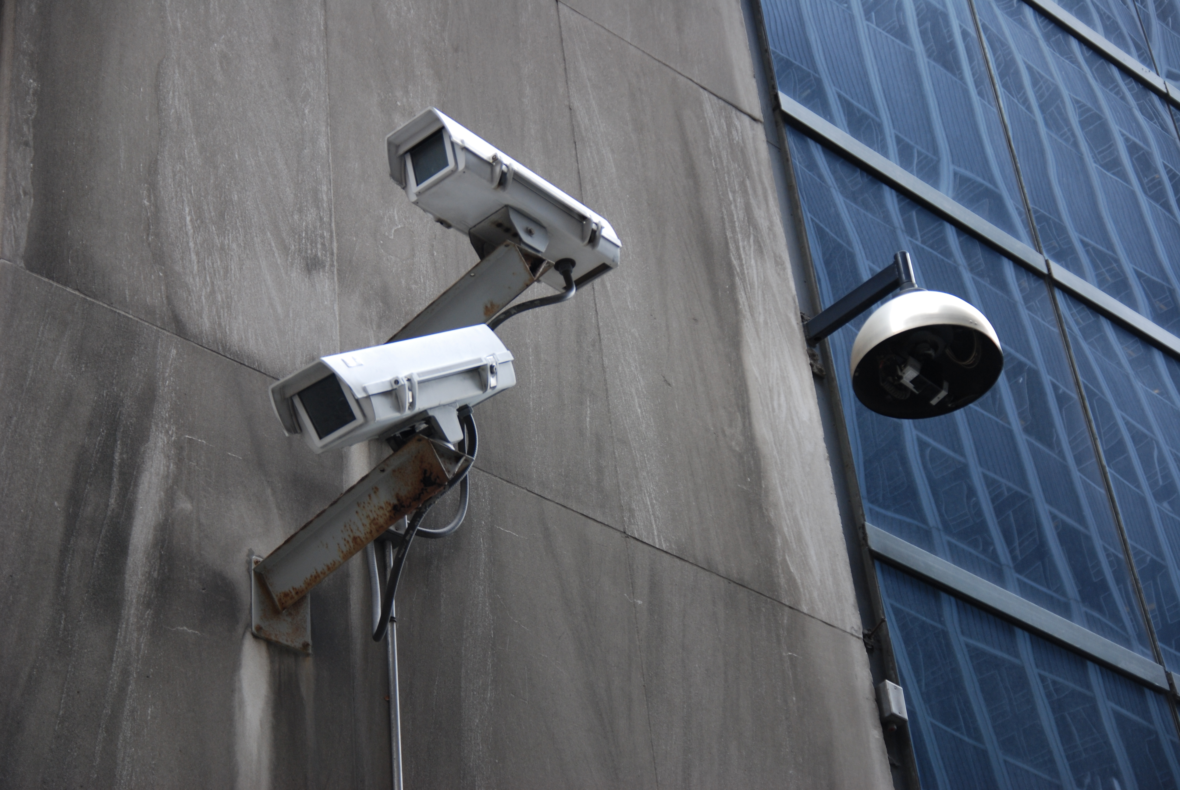 Surveillance in NYC's financial district. Photo by Jonathan McIntosh (flickr).